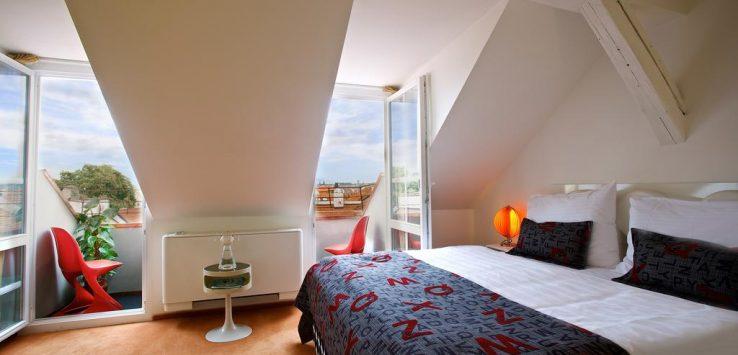 Quarto de hotel em Praga com decoração elegante